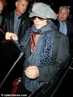 6260462-6396619-Ready_to_split_Depp_opened_up_the_door_to_the_waiting_car_as_he_-m-73_1542363618053